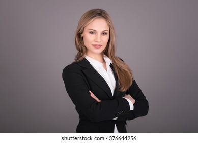 Portrait of wonderful young business woman on gray background