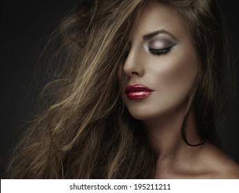 Portrait of wonderful young woman with long hair looking down