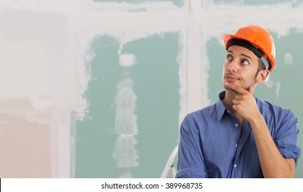 Portrait of a worker in an apartment. Large copy-space