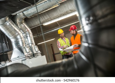 Portrait of a worker, constructing and checking development of a small business hall. Reliable civil engineer working on a construction site, foreman at work