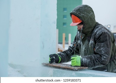 Portrait of a worker at the construction of the ice town for Christmas