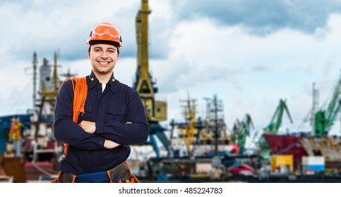 Portrait of a worker in front of an harbor