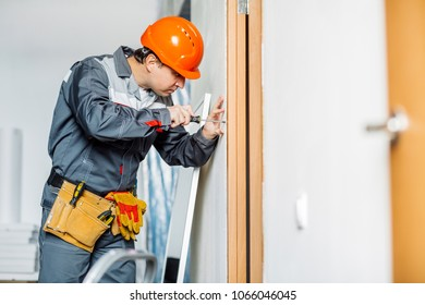 Portrait of a worker with screwdriver. Repair and building concept.