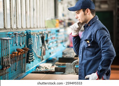 Portrait of a worker searching for the right wrench
