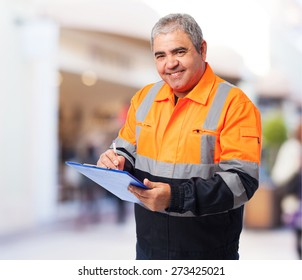 portrait of a worker writing on a paper
