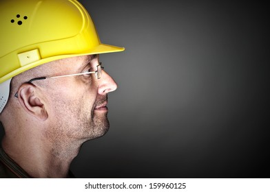 Portrait of a worker with yellow hard hat