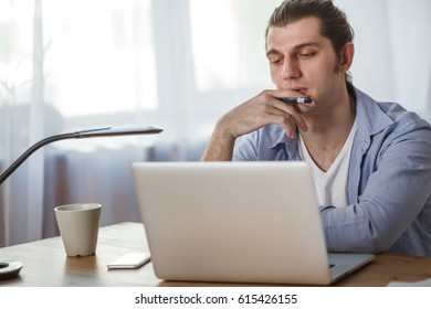 portrait of working man at his home