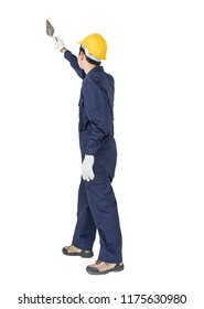 Portrait of a workman with blue coveralls and hardhat in a uniform holding steel trowel on white background with clipping path