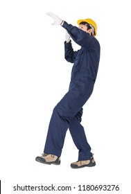 Portrait of a workman with blue coveralls and hardhat in a uniform on white background with clipping path
