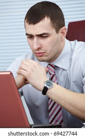 Portrait of a worried businessman looking at computer screen