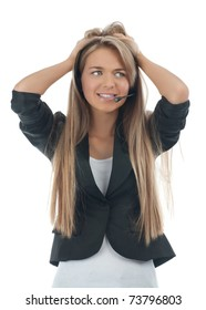 Portrait of a worried female call center employee wearing a headset, against white background