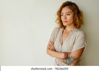 Portrait of worried young woman standing in studio