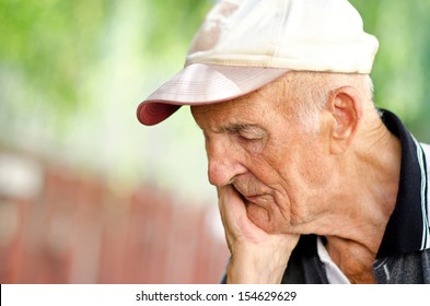 Portrait of a wrinkled and expressive old man outdoor