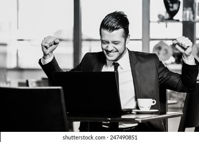 Portrait of yang confident businessman in interior black and white