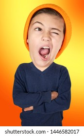 portrait of yawning young boy with big head on orange background