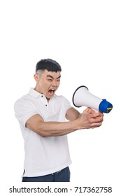 portrait of yelling asian man looking at bullhorn isolated on white
