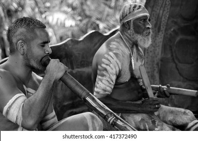 Portrait of Yirrganydji Aboriginal men play Aboriginal music on didgeridoo and wooden instrument during Aboriginal culture show in Queensland, Australia. (BW)