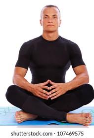 Portrait of yoga trainer meditation in studio