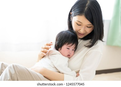portrait of yooung asian baby and mother in living room