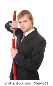 portrait of youn blond man in black suit with katana sword on white
