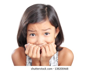 Portrait of a young abused frightened girl.