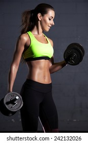 Portrait of young adult active sporty attractive sexy and sensuality beautiful brunette pretty woman at the gym