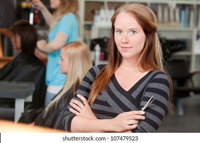 Portrait of young adult hairstylist .