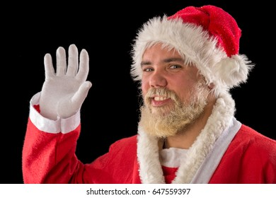 portrait of young adult happy smiling male with santa costume, studio shoot isolated on black