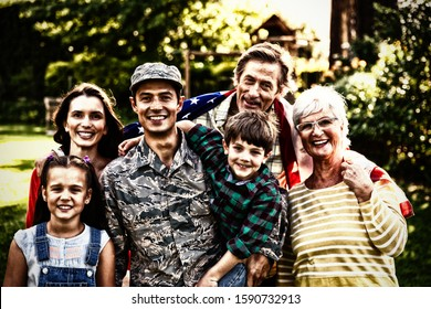 Portrait of a young adult mixed race male soldier and his diverse multi-generation family in the garden outside their home, embracing and smiling to camera