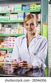 portrait of young adult pharmacist looking at camera