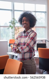 Portrait of a young African American casual business woman in a modern office