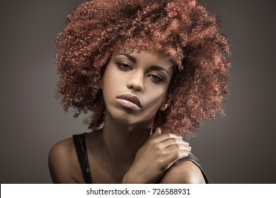 Portrait of young african american girl with afro  . Studio shot.