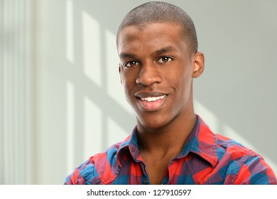 Portrait of young African American indoors