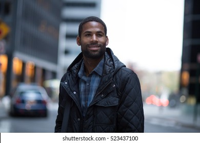 Portrait of young African American professional in the city, photographed in NYC in November.