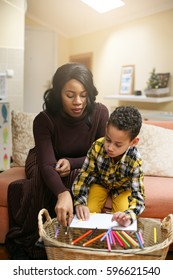Portrait of a young African American woman and her son drawing and communicate.