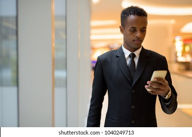 Portrait of young African businessman exploring the city of Bangkok, Thailand