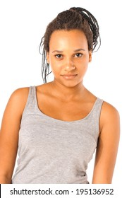 Portrait of a young african girl with black dreadlocks looks with a light smile at the camera, isolated over white background.