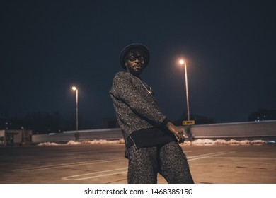 portrait of young african man dancing in parking space– self control, youth, viewpoint
