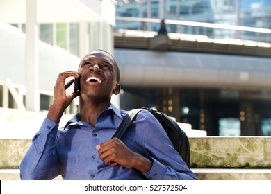 Portrait of young african man talking on mobile phone and smiling