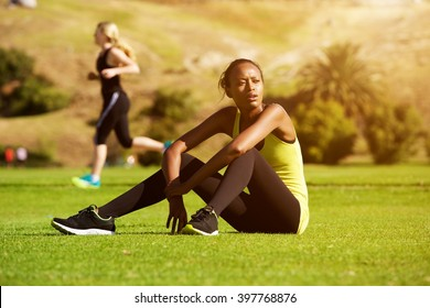 Portrait of young african sports woman relaxing outdoors after workout