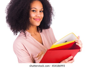 Portrait Of Young African student woman posing over white background