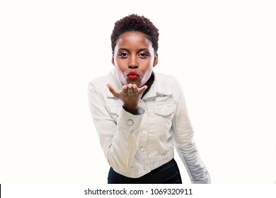 Portrait of young african woman blowing a kiss