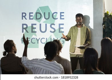 Portrait of young African-American man giving speech on recycling and waste management during conference, copy space