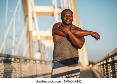 Portrait of young african-american man in sports clothing who is exercising to reduce his body weight.
