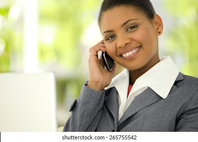 Portrait of a young Afro American Businesswoman giving a phone call with smart phone