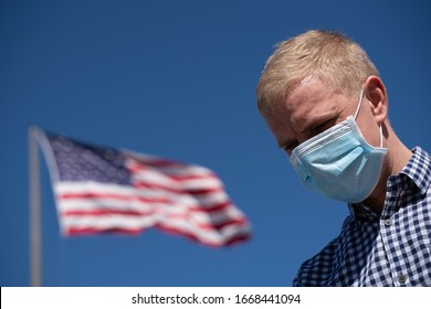 Portrait of young American man wearing protective mask against the coronavirus