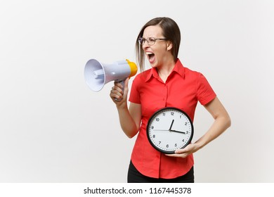 Portrait of young angry business teacher woman in red shirt holding round clock, scream in megaphone, announces discounts sale, isolated on white background. Hot news, communication concept. Hurry up