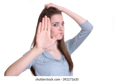Portrait young annoyed angry woman with bad attitude giving talk to hand gesture with palm