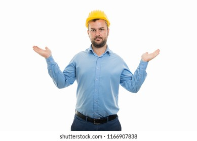 Portrait of young architect with yellow helmet showing don't know gesture isolated on white background with copyspace advertising area