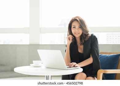Portrait of young asia business woman in the office
